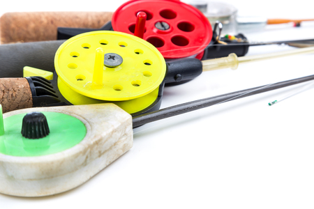 fishing reel: closeup ice-fishing rods, tackles and equipment on white background Stock Photo