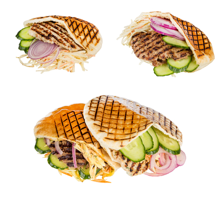 arabian food: set arabian grilled hot fast food - meat with vegetables in pita