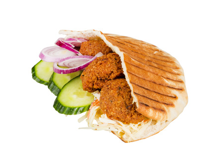 arabian grilled hot fast food - meat with vegetables in pita