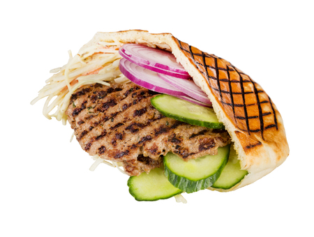 arabian food: arabian grilled hot fast food - meat with vegetables in pita