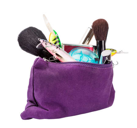 unexrected woman beautican bag with cosmetic tools and fishing tackles. isolated for advertisement, poster and other Stock Photo