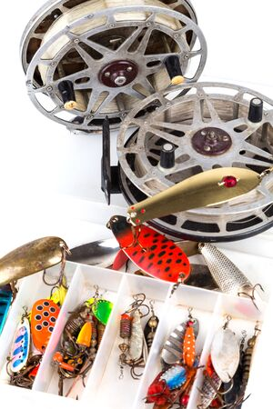 storage box: fishing lure in storage box and lading reels with line Stock Photo