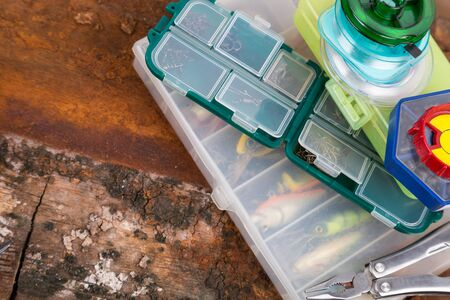baits: fishing tackles and baits in storage boxes Stock Photo