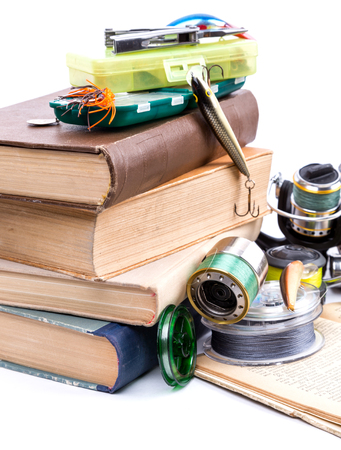 tackles: outdoor fishing tackles and baits with books on white background