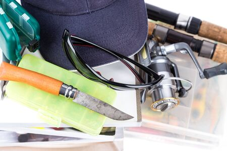 clasp knife: fishing tackles and baits with books on white background for outdoor business