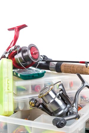fishing tackles and baits in box on wooden boards background for outdoor active business