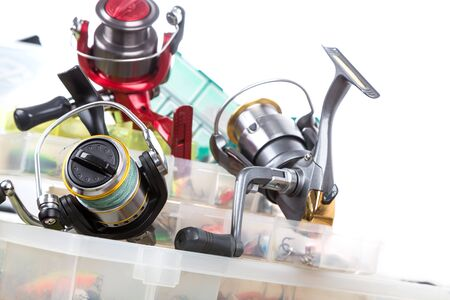 wobler: fishing tackles and baits in box on wooden boards background for outdoor active business
