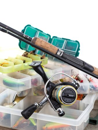 wobler: fishing tackles and lures in box on wooden boards background for outdoor active business
