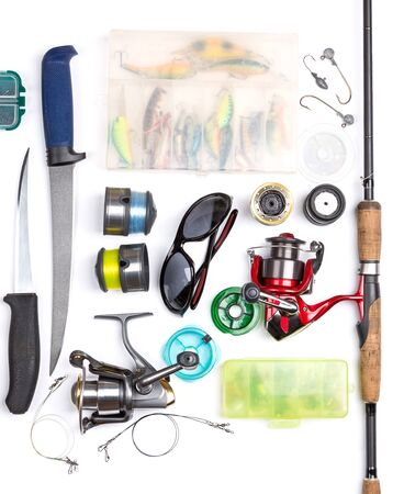 wobler: top view on fishing tackles with white background. mokap for outdoore adventure business Stock Photo