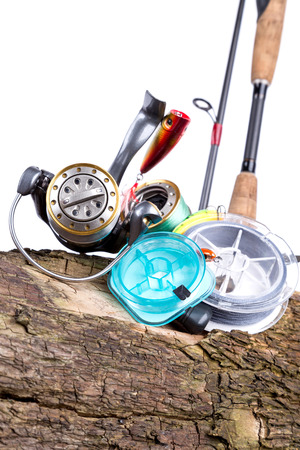 plummet: fishing tackles and fishing baits on wooden background. Idea for angling sport business - templates, web, poster, card, advertisement. Stock Photo