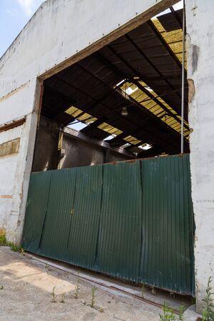 deserted: green metal fence in deserted wharehouse