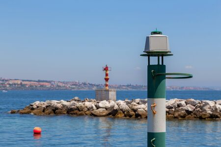 navigation baken on coast a sea before port