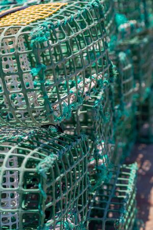 crab pots: heap square green crab traps in marine