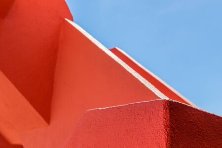 rugger: abstract geometry of orange rugger bending construction with blue sky