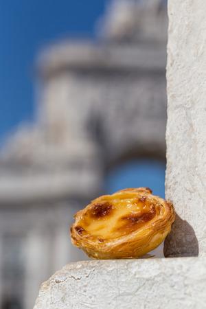 nata: Traditional Portuguese egg tart pasty cake dessert Pasteis de nata on background attractions in Lisbon, Portugal.