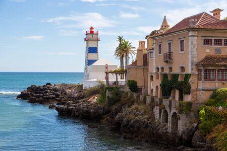 marta: lighthouse on ocean coast in bay cascais in summer day