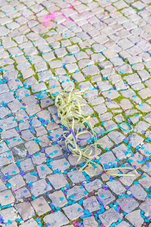 background from carnaval street with confetti and tape