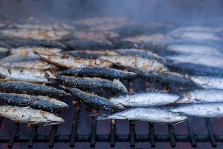 sardines on grill on street bbq. hot tipical portugese food Banco de Imagens