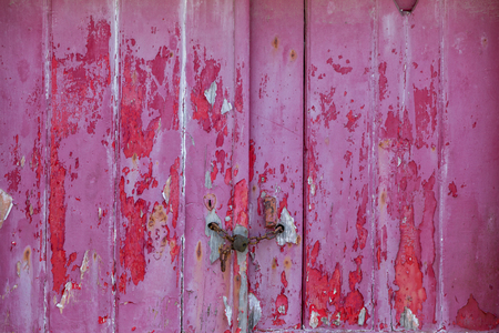 old raspberry colorer door with damaged texture