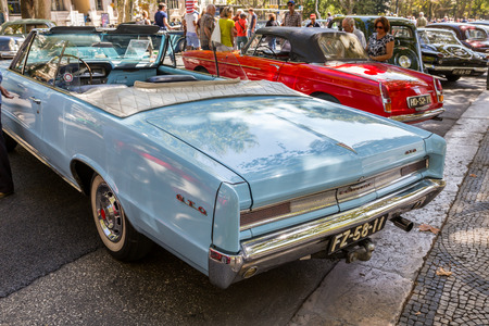 restored: Lisbon, Portugal - september 24, 2017: Reto car show on street of the city. european and american old classic automobiles