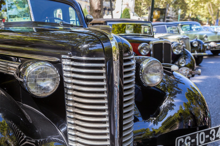 custom car: Lisbon, Portugal - september 24, 2017: Reto car show on street of the city. european and american old classic automobiles