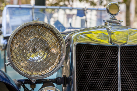 Details reto car show on street of the city. european and american old classic automobiles
