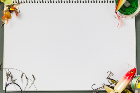 big notebook with fishing tackles on color paper background. outdoors activity sport and relax 스톡 콘텐츠