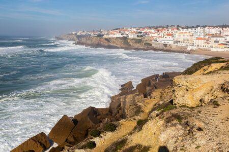 Beach on ocean coast, moviment waves with foam. Praia de Maca, Sintra, Portugal