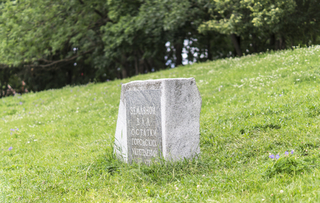 smudgy: stone slab monument with green grass on background