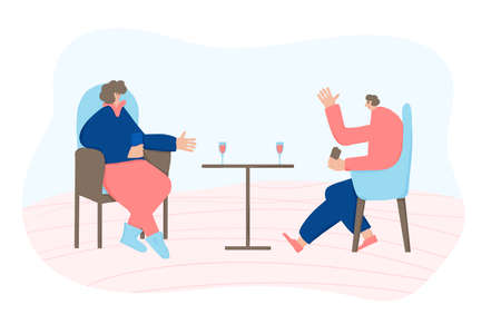 Date concept. Two adult persons sitting in the chair and having small talk. Friends spending time together at home with wine. Couple enjoying their free time.