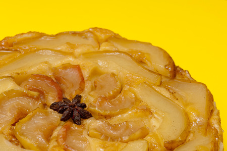 Tarte Tatin apple and pear tart pie isolated on yellow background with copy space