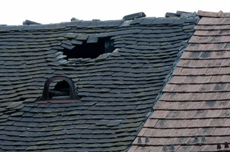 damaged roof: Damaged old tiled roof broken leaked
