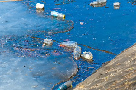 Waste, trash and garbage floated on a polluted river Stock Photo