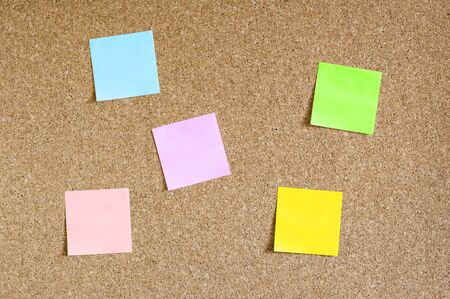 Corkboard with colorful sticky notes Stock Photo