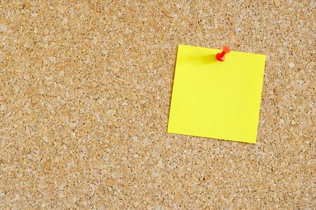 Cork board with yellow post-it Stock Photo - 17308316