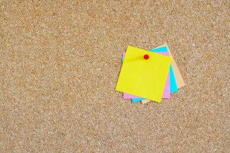Cork board with colorful post-it