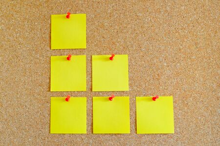 Cork board with multiple yellow post-it