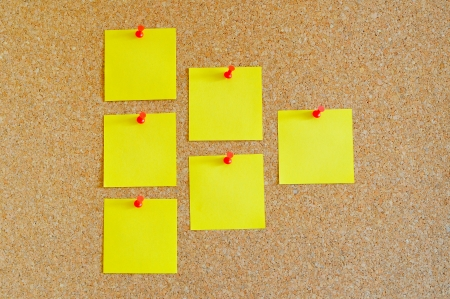 Cork board with multiple yellow post-it Stock Photo - 17580505