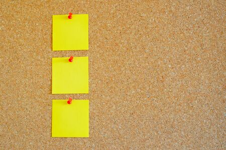 Cork board with multiple yellow post-it Stock Photo - 17580502
