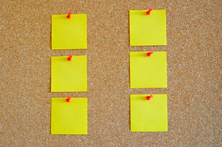 Cork board with multiple yellow post-it Stock Photo - 17580503