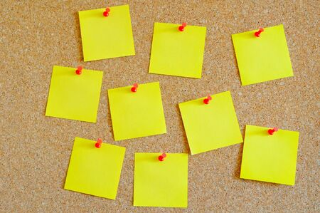 Cork board with multiple yellow post-it Stock Photo - 17580499
