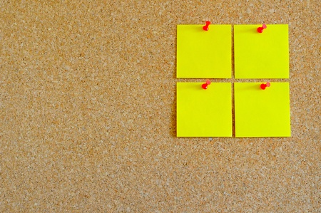 Cork board with multiple yellow post-it Stock Photo - 17580495