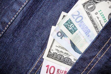 money in the pocket: Pocket money various currency bills in jeans. Foto de archivo