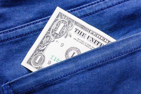 bolsa dinero: El dinero de bolsillo de un dólar. Foto de archivo