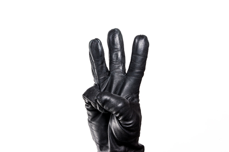 thread count: Showing fingers hand in black leather glove isolated on white. Stock Photo