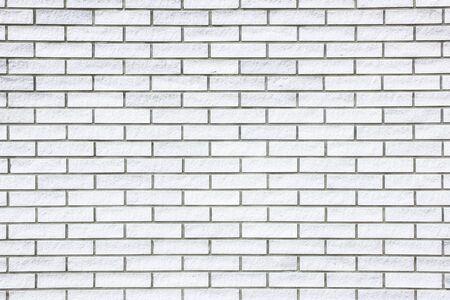 faade: White brick wall background.