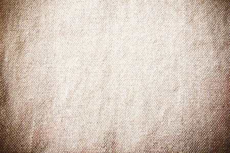 Brown fabric background. Warm color canvas texture. Bright textile material background. Closeup fiber pattern. Checkered textile texture.