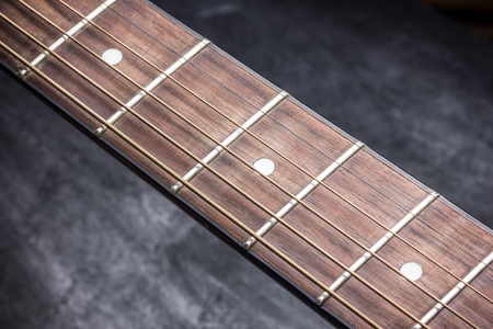 Grunge guitar fret board background.