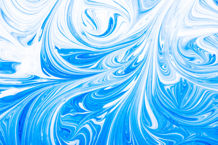 Blue and white paint mixing swirl background. Stock Photo