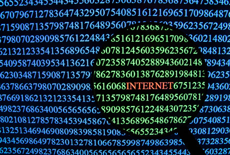 spyware: Numbers on computer screen with magnifying glass focusing on internet word background.